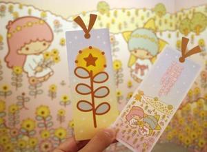 サンリオのキャラクター、キキとララがインターネット上で育てた「希望の花」のしおり